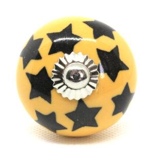 Grand bouton de meuble jaune étoilé