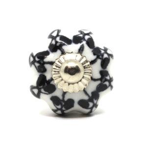 Petite poignée de meuble forme fleur noir et blanc
