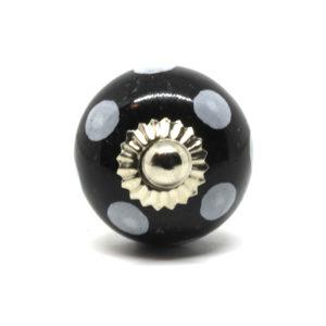 Petit bouton de meuble noir à pois blancs