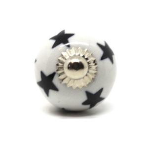 Petit bouton de meuble noir et blanc motifs étoilés