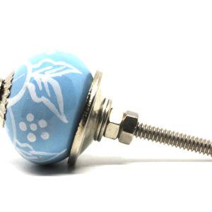 Petit bouton de meuble bleu ciel motifs blancs