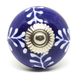 Bouton de meuble bleu aux motifs blancs relief